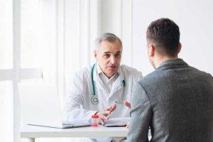 man talks to doctor at Portland detox center