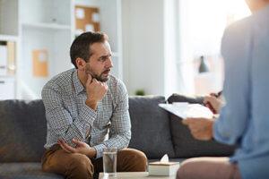 a man talking to a therapist at Hillsboro Drug Rehab Center