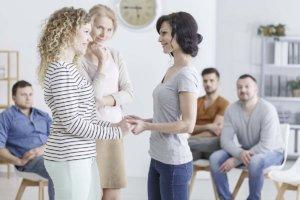 two women holding hands at Eugene Heroin Rehab Center (2)
